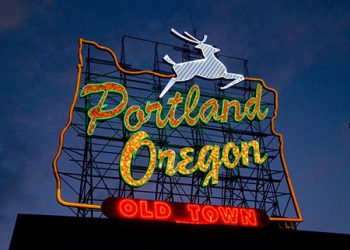 Portland Oregon White Stag sign at dusk